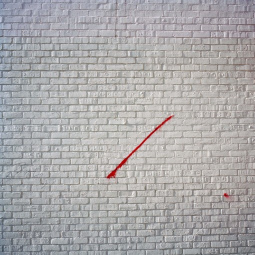Red slash on a white brick wall