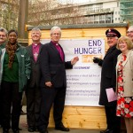 Photo of Bishop David with church leaders and food bank volunteers at the launch of the End Hunger Fast campaign.