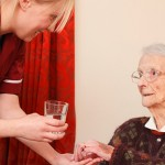 Social care worker on home visit