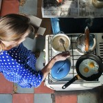Stock photo showing a woman cooking in a domestic kitchen