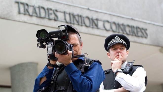Police photographer and police officer at the TUC
