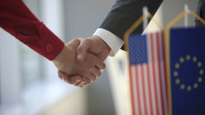 handshake between US and EU representatives