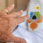 patient reaching for help button