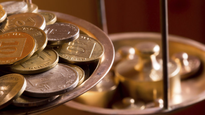 coins on scales