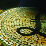 Walking past a pound coin mosaic