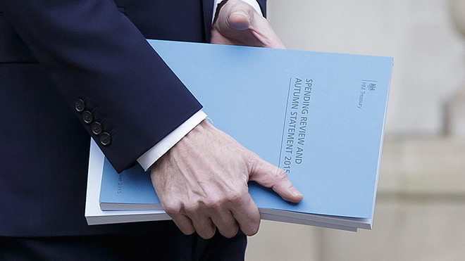 George Osborne carries the 2015 Spending Review as he leaves the Treasury. Photo: Tim Ireland / PA Images