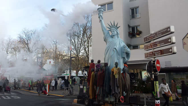 'Freedom to Pollute' Public awareness event in Montreuil showing the impact of rich countries like the USA on poorer countries.