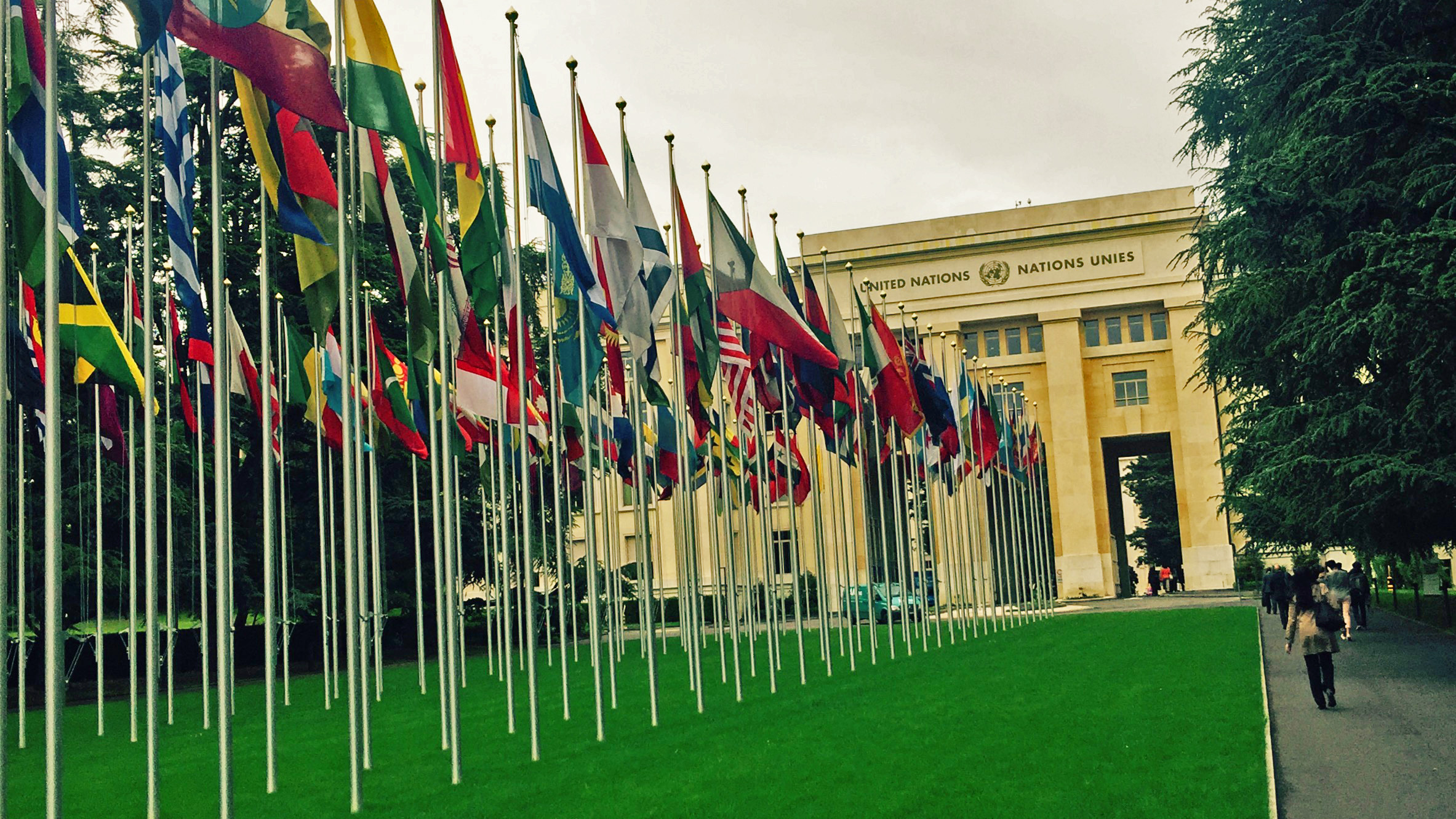 UN flags in a row before an arch in Geneva's Palais des Nations where the ILO is taking place