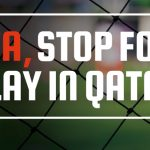 "A campaign sign reads ""FIFA, Stop Foul Play in Qatar"""