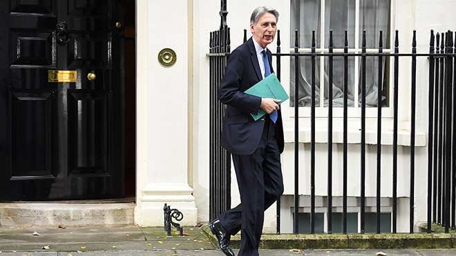 Philip Hammond leaves Downing Street to deliver his Autumn Statement