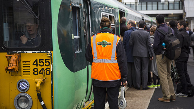 Southern Rail conductor checks a train at East Croydon station