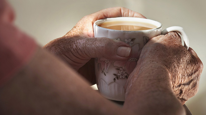 Pensioner with a cup of tea