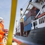 Dock workers in Grimsby with container ship.