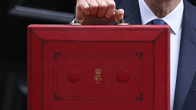 Philip Hammond holds the Budget red briefcase