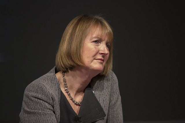 Harriet Harman MP against a black background